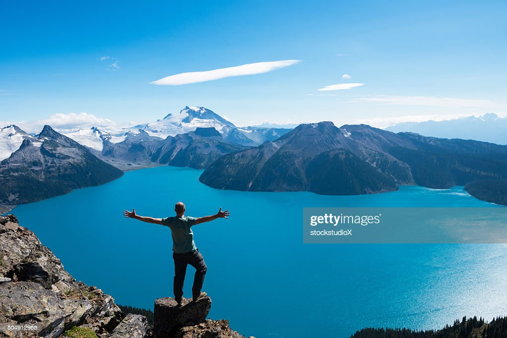 Celebrating a personal victory in stunning nature : Stock Photo