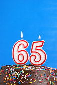 A number candle is lit in celebration of sixty five years.