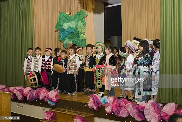 Celebrating the Hmong New Year Hmong language and culture charter school St Paul Minnesota United States 2nd and 3rd grade Hmong students take a...