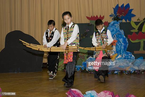Celebrating the Hmong New Year Hmong language and culture charter school St Paul Minnesota United States 4th and 5th grade students play the Qeej at...