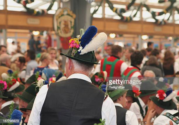 Celebration at the Oktoberfest inside a bavarian tent