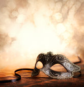 venetian carnival mask with glittering backround and copy space