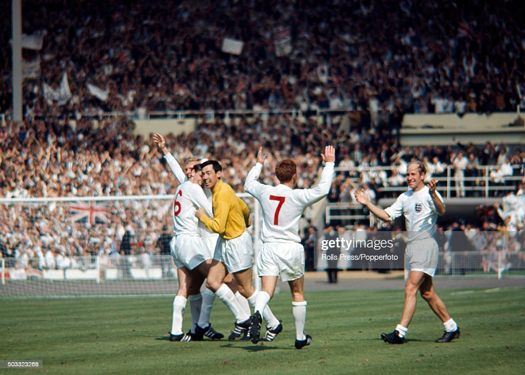 Celebrations for England after Geoff Hurst had scored the winning goal during the FIFA World Cup Quarter Final match between England and Argentina at Wembley stadium in London, 23rd July 1966. Left-right: Martin Peters hugs <a gi-track='captionPersonalityLinkClicked' href=/galleries/search?phrase=Bobby+Moore&family=editorial&specificpeople=206646 ng-click='$event.stopPropagation()'>Bobby Moore</a> (6), <a gi-track='captionPersonalityLinkClicked' href=/galleries/search?phrase=Gordon+Banks&family=editorial&specificpeople=215465 ng-click='$event.stopPropagation()'>Gordon Banks</a> (yellow shirt), <a gi-track='captionPersonalityLinkClicked' href=/galleries/search?phrase=Alan+Ball+-+World+Cup+Winner&family=editorial&specificpeople=213401 ng-click='$event.stopPropagation()'>Alan Ball</a> (7) and <a gi-track='captionPersonalityLinkClicked' href=/galleries/search?phrase=Bobby+Charlton&family=editorial&specificpeople=204207 ng-click='$event.stopPropagation()'>Bobby Charlton</a>. England won 1-0.