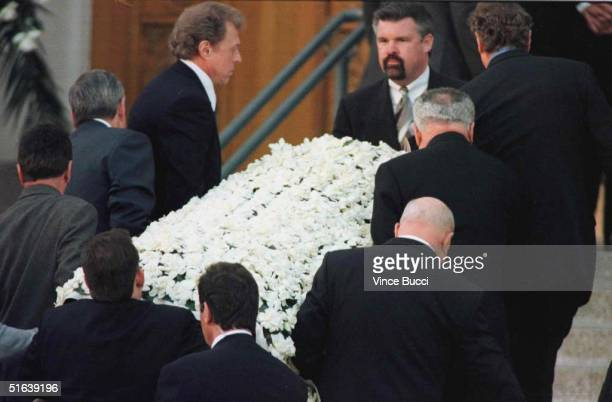 Celebrities and friends of the late Frank Sinatra carry his casket into the Good Shepard Catholic Church in Beverly HillsCA 19 May during a private...