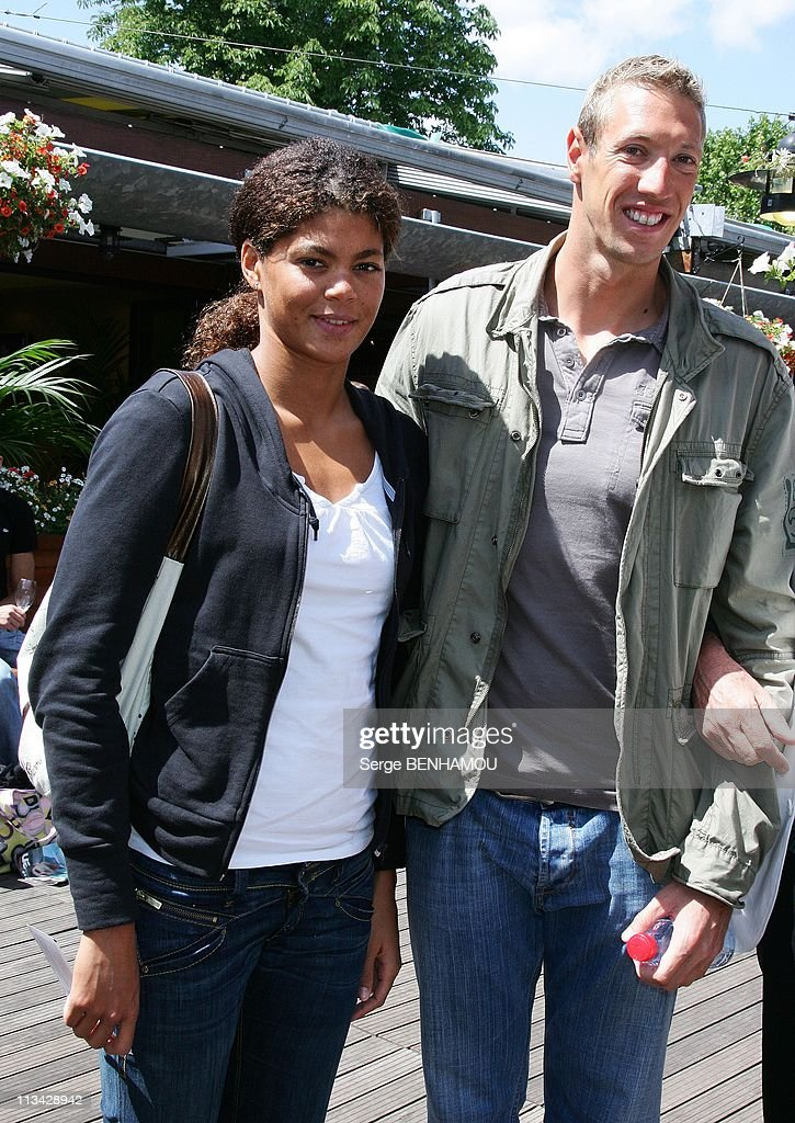 Celebrities At 2009 Roland Garros Tournament In Paris France On June 07 2009 Alain Bernard and Coralie Balmy