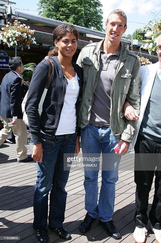 Celebrities At 2009 Roland Garros Tournament In Paris France On June 07 2009 Alain Bernard and his girlfriend Coralie Balmy