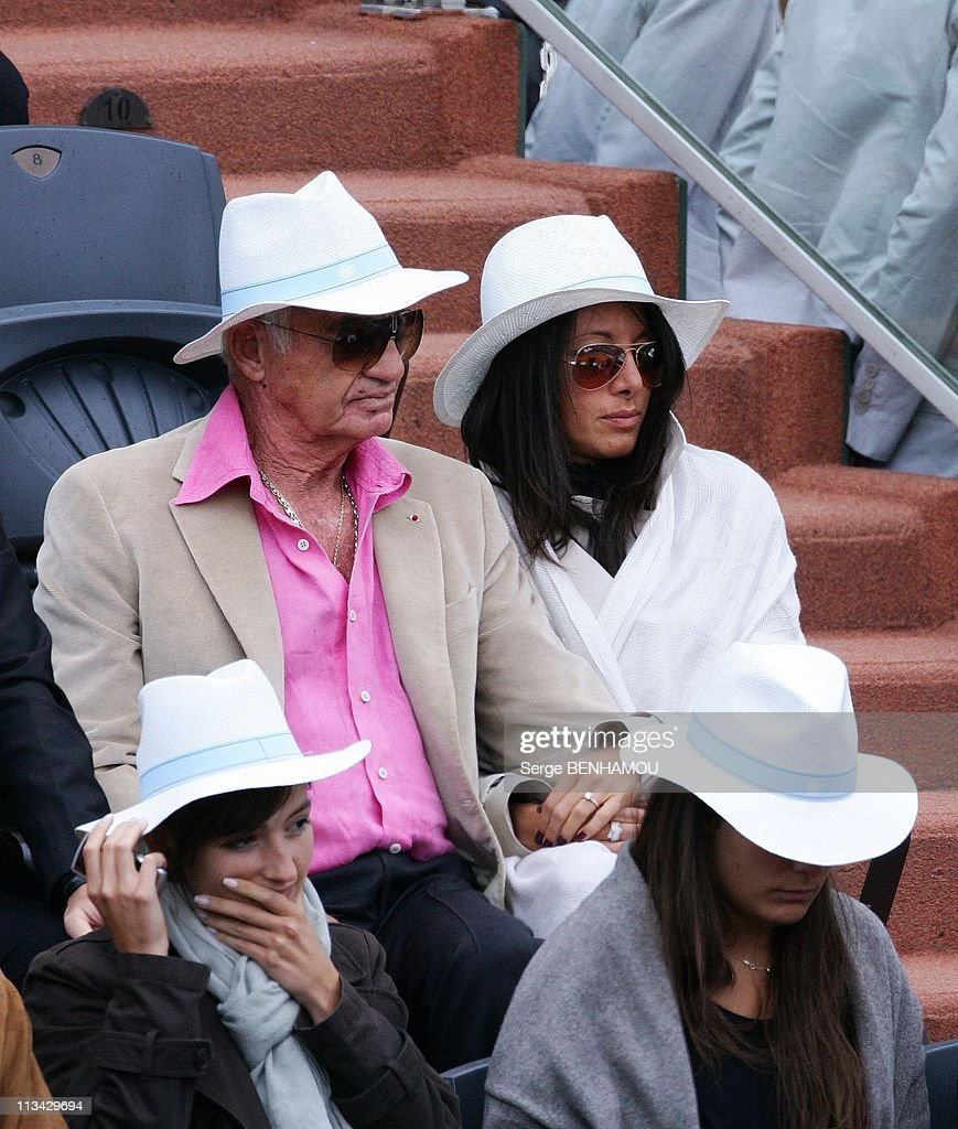 Celebrities At 2009 Roland Garros Tournament In Paris, France On June 07, 2009 - <a gi-track='captionPersonalityLinkClicked' href=/galleries/search?phrase=Jean-Paul+Belmondo&family=editorial&specificpeople=207029 ng-click='$event.stopPropagation()'>Jean-Paul Belmondo</a> and <a gi-track='captionPersonalityLinkClicked' href=/galleries/search?phrase=Barbara+Gandolfi&family=editorial&specificpeople=5661747 ng-click='$event.stopPropagation()'>Barbara Gandolfi</a>.