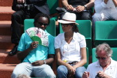 Celebrities At 2009 Roland Garros Tournament In Paris France On May 25 2009 Peggy Luyindula and his friend