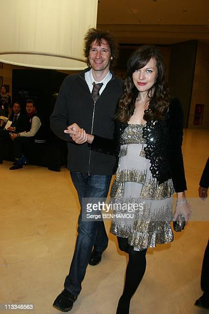 Celebrities At Elie Saab Ready To Wear SpringSummer Fashion Show In Paris France On October 04 2008 Milla Jovovich and her friend Paul W Anderson