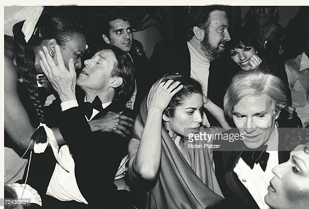 Celebrities during New Year's Eve party at Studio 54 Halston [kissing unidentified] Bianca Jagger Jack Haley Jr and wife Liza Minnelli Andy Warhol...