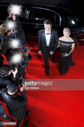 Celebrities walking on red carpet : Stock Photo