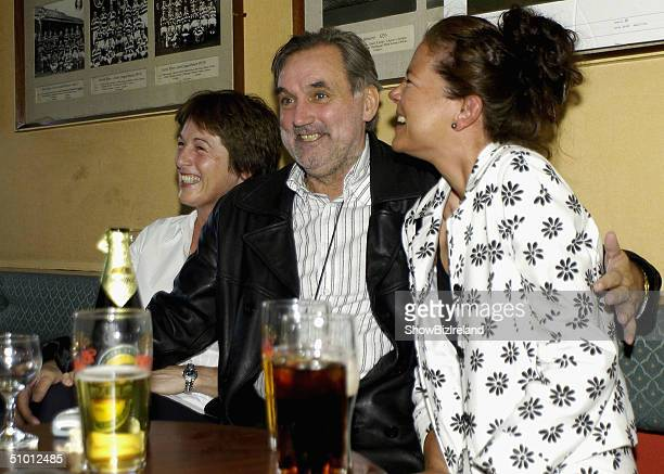 Celebrity and former soccer legend George Best enjoys the company of some revellers at the Old Wesley Rugby Club on June 28 2004 Dublin Ireland