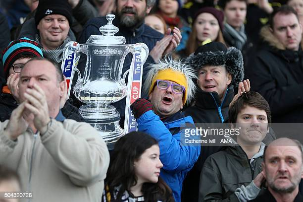 Celebrity and Oxford United fan Timmy Mallett celebrates with a cardboard FA Cup trophy during The Emirates FA Cup match between Oxford United and...