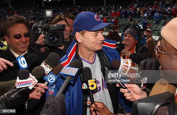 Celebrity Bill Murray clowns around with Chicago media before the opening day game between the Chicago Cubs and the Pittsburgh Pirates on April 12...