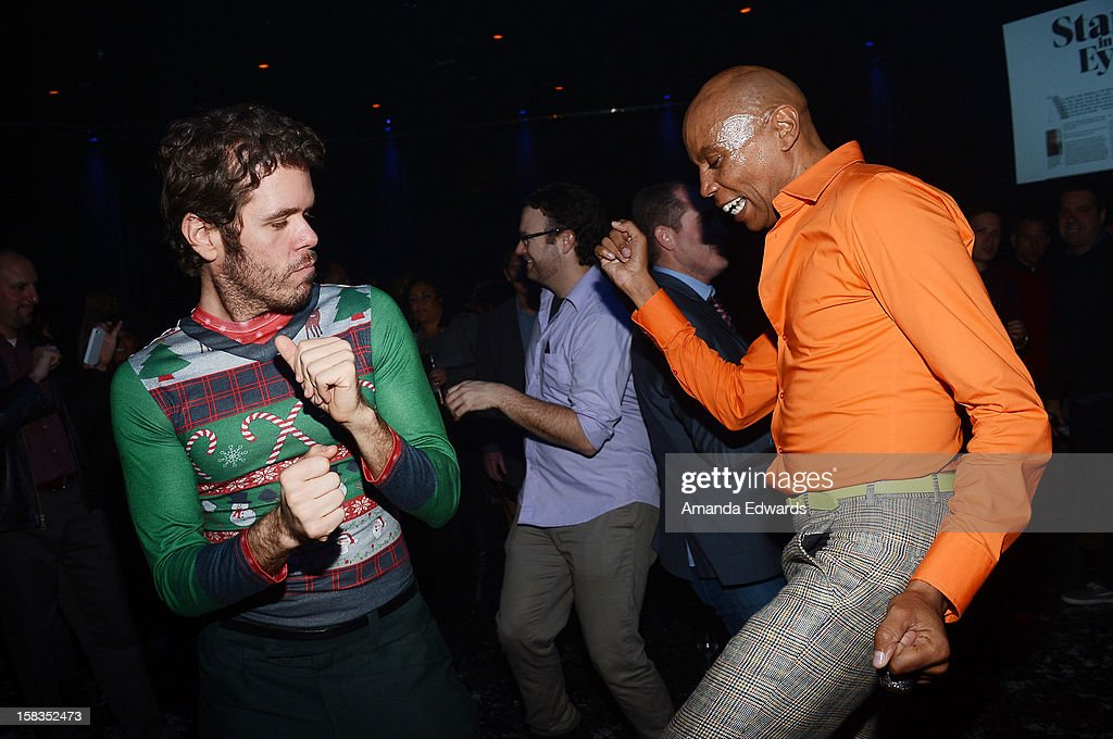 Celebrity blogger Perez Hilton (L) and drag queen RuPaul attend the World Of Wonder book release party/birthday bash at The Globe Theatre at Universal Studios on December 13, 2012 in Universal City, California.