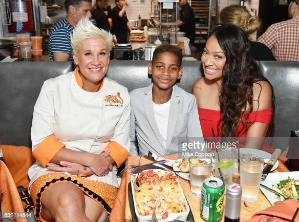 Celebrity chef Anne Burrell Kiyan Anthony and La La Anthony pose for a photo as The Spotted Cheetah opens in New York City serving up a limitedtime...