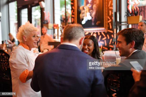Celebrity chef Anne Burrell mingles with guests as the Cheetosthemed restaurant opens in New York City serving up a limitedtime Cheetosinfused...