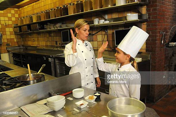 Celebrity Chef Cat Cora Cooks With Grace LaFountain The Winner Of The National Loukoumi's Celebrity Cookbook 'Favorite Childhood Recipe' Contest at...