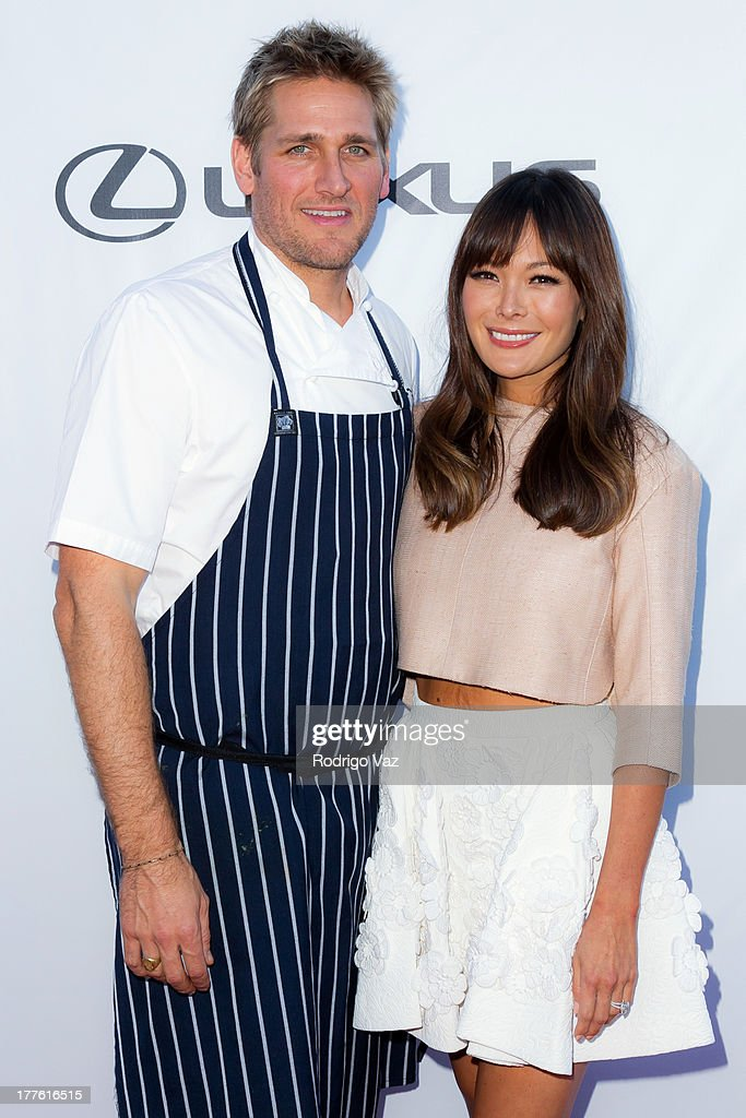 Celebrity chef Curtis Stone (L) and actress Lindsay Price attend LEXUS Live On Grand at the 3rd Annual Los Angeles Food & Wine Festival Arrivals on August 24, 2013 in Los Angeles, California.