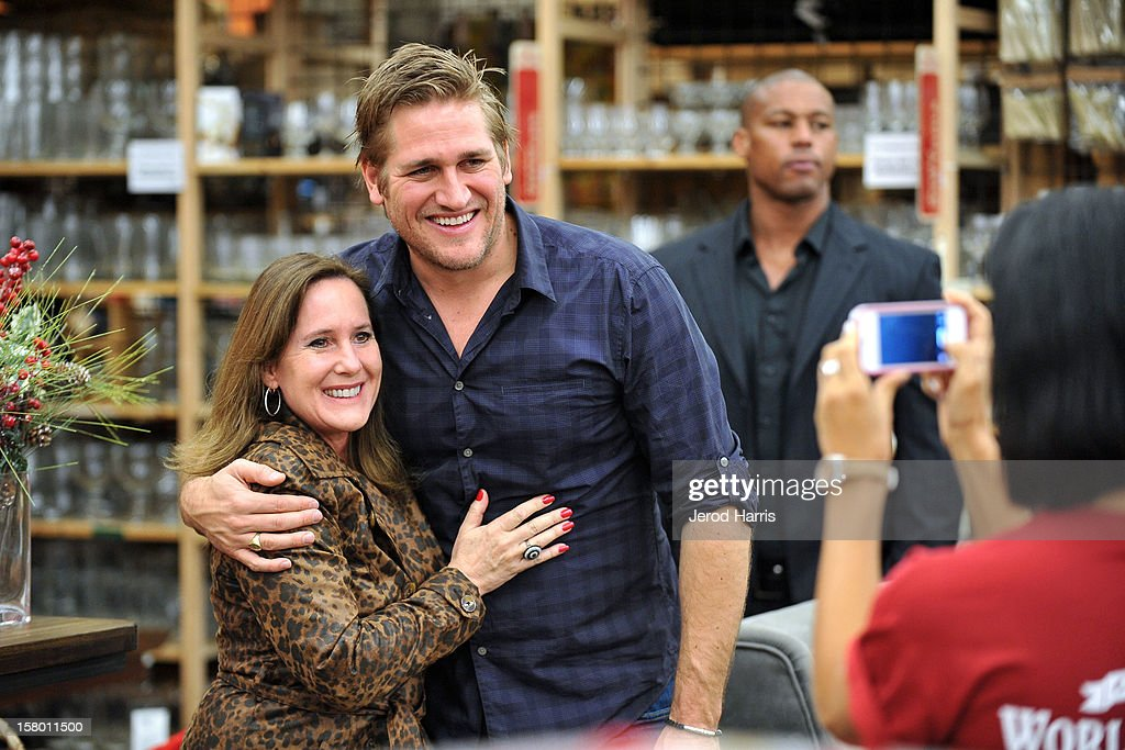 Celebrity Chef <a gi-track='captionPersonalityLinkClicked' href=/galleries/search?phrase=Curtis+Stone&family=editorial&specificpeople=215291 ng-click='$event.stopPropagation()'>Curtis Stone</a> meets fans at Cost Plus World Market's Share the Joy event at Cost Plus World Market on December 8, 2012 in Los Angeles, United States.