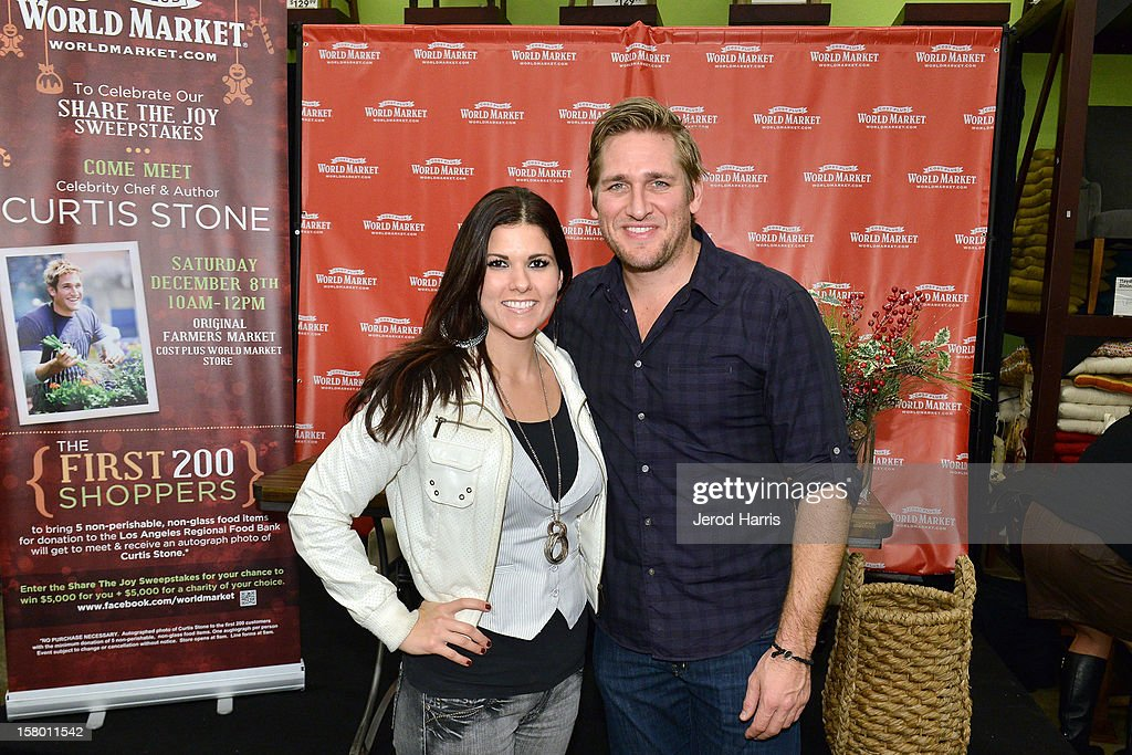 Celebrity Chef Curtis Stone poses with fans at Cost Plus World Market's Share the Joy event at Cost Plus World Market on December 8, 2012 in Los Angeles, United States.