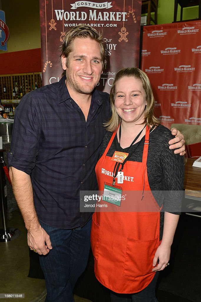 Celebrity Chef Curtis Stone poses with store manager Amanda Keller at Cost Plus World Market's Share the Joy event at Cost Plus World Market on December 8, 2012 in Los Angeles, United States.
