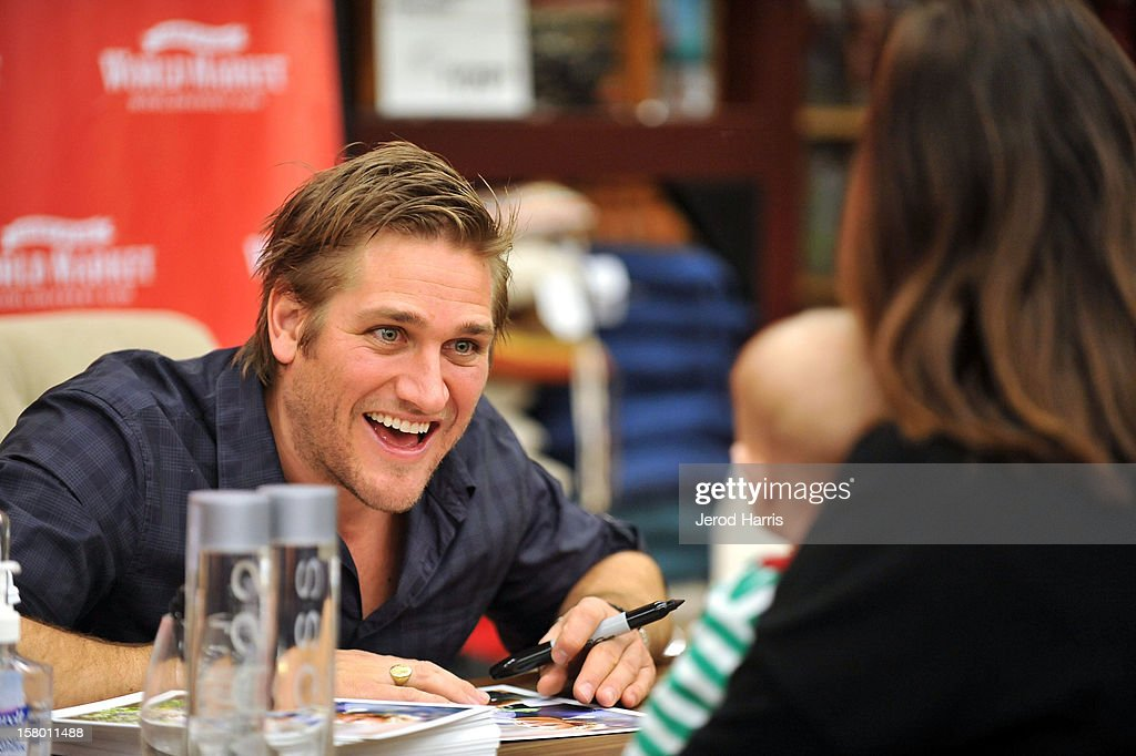 Celebrity Chef Curtis Stone signs autographs for fans who donated canned food at Cost Plus World Market's Share the Joy event at Cost Plus World Market on December 8, 2012 in Los Angeles, United States.