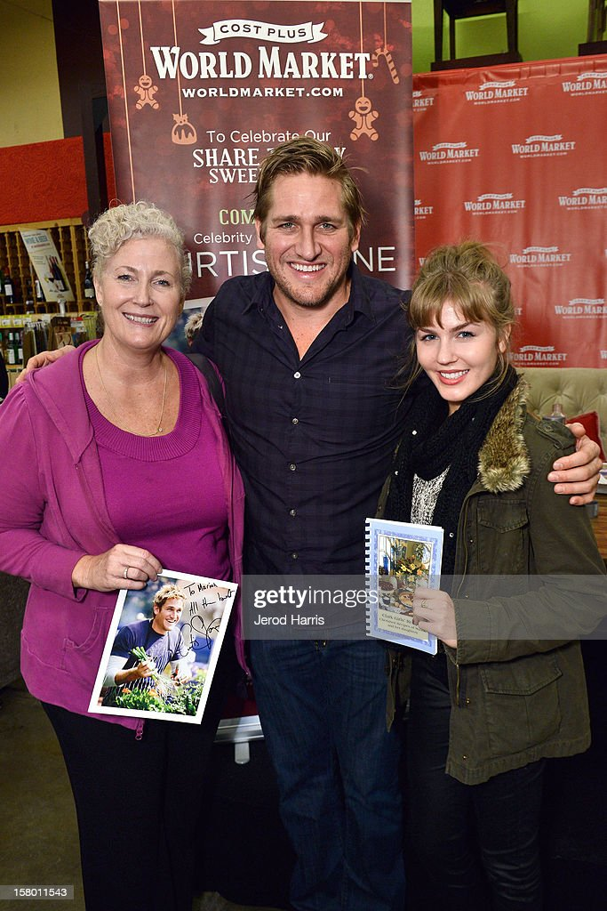Celebrity Chef Curtis Stone with Mariah Parks (L) and guest attend Cost Plus World Market's Share the Joy event at Cost Plus World Market on December 8, 2012 in Los Angeles, United States.