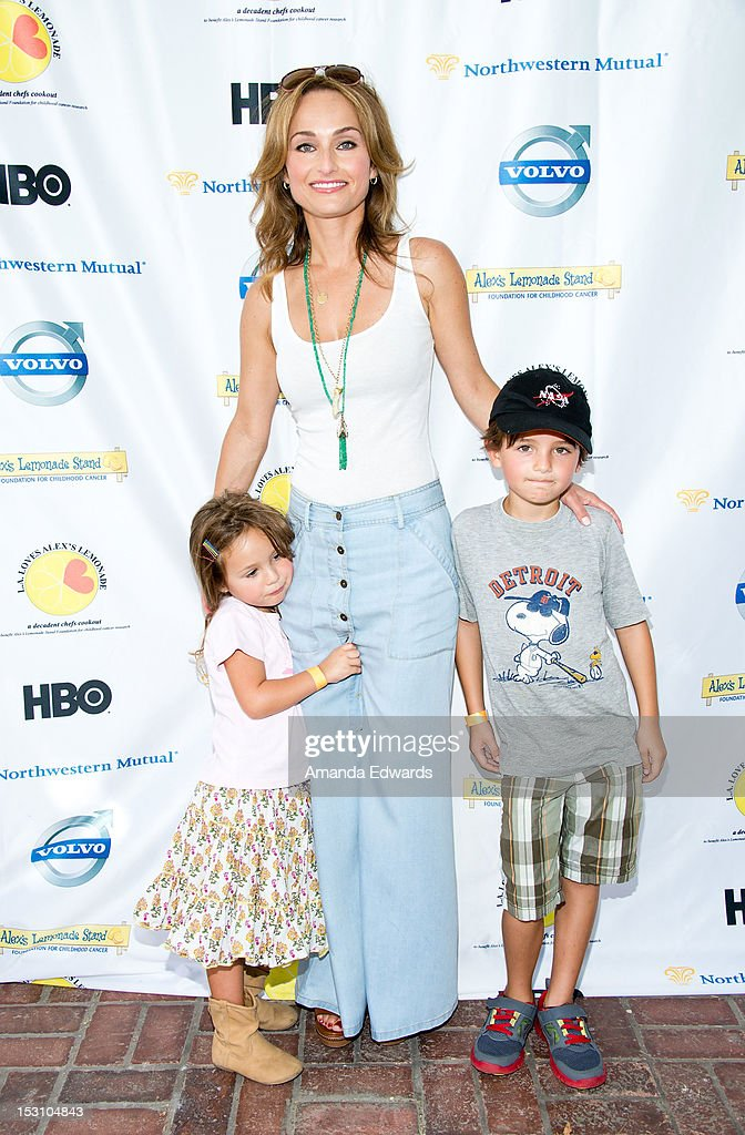 Celebrity chef <a gi-track='captionPersonalityLinkClicked' href=/galleries/search?phrase=Giada+De+Laurentiis&family=editorial&specificpeople=601210 ng-click='$event.stopPropagation()'>Giada De Laurentiis</a> (C), her daughter <a gi-track='captionPersonalityLinkClicked' href=/galleries/search?phrase=Jade+Thompson&family=editorial&specificpeople=8316630 ng-click='$event.stopPropagation()'>Jade Thompson</a> (L) and her nephew Julian Vaguelsy (R) arrive at the L.A. Loves Alex's Lemonade Culinary Event at Culver Studios on September 29, 2012 in Culver City, California.
