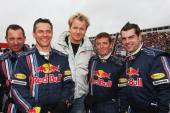 Celebrity chef Gordon Ramsay meets Red Bull Racing mechanics on the grid before the British Formula One Grand Prix at Silverstone on July 6 2008 in...