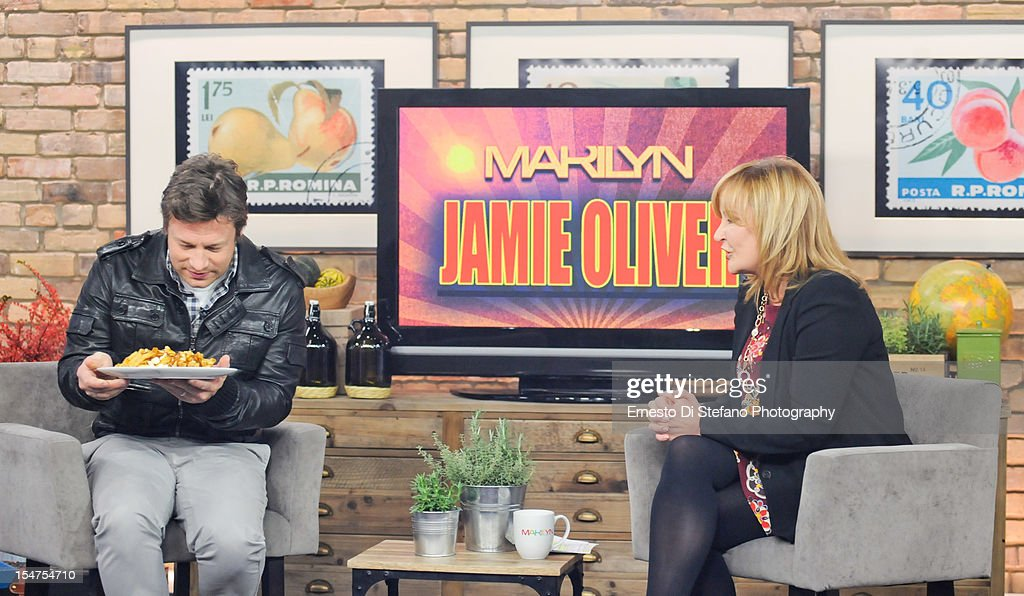 Celebrity Chef <a gi-track='captionPersonalityLinkClicked' href=/galleries/search?phrase=Jamie+Oliver&family=editorial&specificpeople=159384 ng-click='$event.stopPropagation()'>Jamie Oliver</a> and Host Marilyn Denis appear on the Marilyn Denis Show on October 19, 2012 in Toronto, Canada.