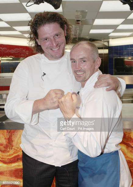 Celebrity chef Marco PierreWhite celebrates with Hell's Kitchen 2007 winner Barry McGuigan seconds after McGuigan was announced the overall winner of...