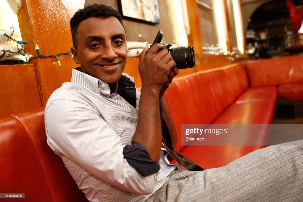 Celebrity chef Marcus Samuelsson talks with guests at Red Rooster for Canon's THE BIG MOMENT with Marcus Samuelsson with the world's smallest and...