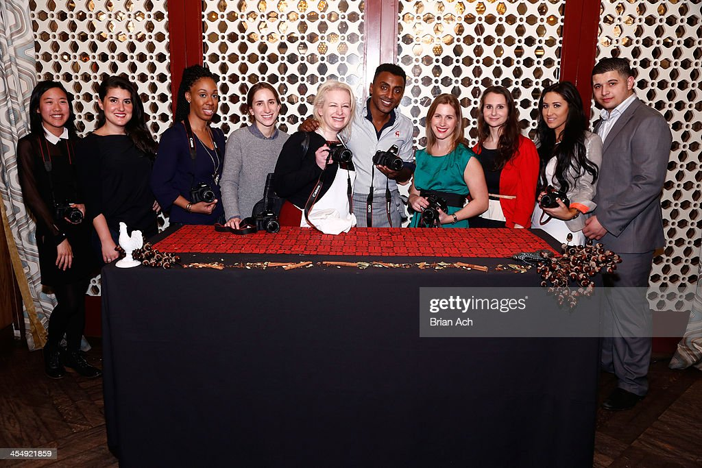 Celebrity chef Marcus Samuelsson with guests at Red Rooster for Canon's THE BIG MOMENT with Marcus Samuelsson with the world's smallest and lightest...
