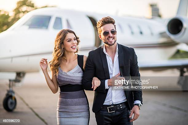 Celebrity couple leaving the private jet airplane