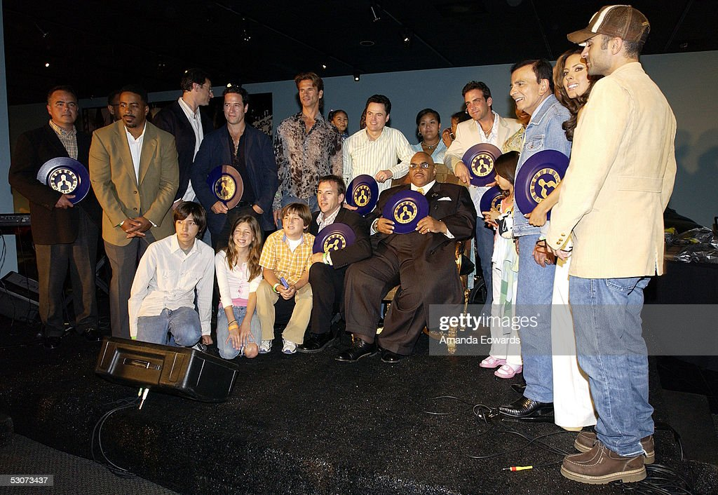 Celebrity dads and their children pose onstage at the Golden Dads Awards ceremony at the Peterson Automotive Museum on June 15, 2005 in Los Angeles, California.