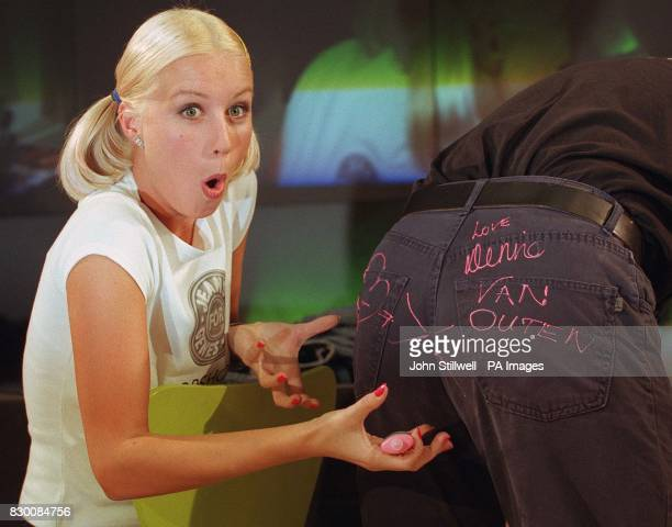 TV celebrity Denise Van Outen jokes during signing a pair of jeans at Top Shop in Oxford Circus London today to sign customer's jeans for Great...