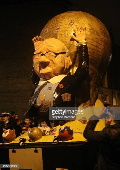 A celebrity effigy of FIFA President Sepp Blatter is paraded by members of local Bonfire societies through the streets of Lewes to celebrate Bonfire...