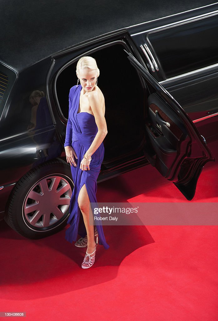 Celebrity emerging from limo on red carpet : Stock Photo
