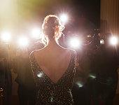 Celebrity facing paparazzi photographers at event