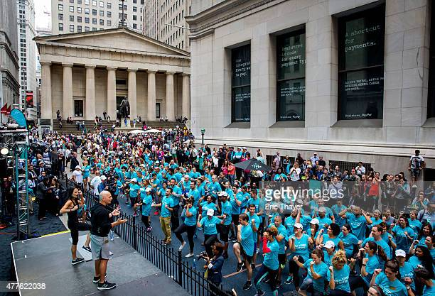Celebrity fitness trainer Harley Pasternak and actress Jordana Brewster lead a Fitbit lunchtime workout event outside the New York Stock Exchange...