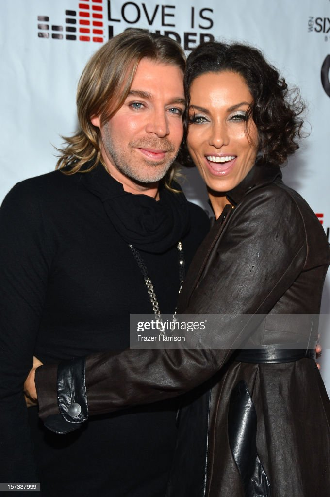Celebrity Hair Stylist Chaz Dean and television personality Nicole Murphy arrive at Chaz Dean's Holiday Party Benefitting the Love is Louder Movement on December 1, 2012 in Los Angeles, California.