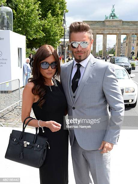 Celebrity impersonators of Victoria Beckham and David Beckham attend the Shai Shalom show during the MercedesBenz Fashion Week Berlin Spring/Summer...