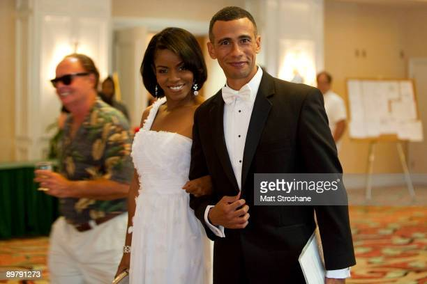 Celebrity impersonators Ron Butler as US President Barack Obama and Vernetta Jenkins as First Lady Michelle Obama both of Los Angeles pose for a...