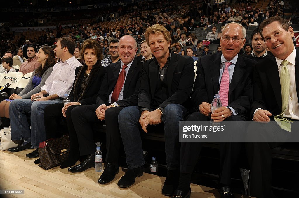 Celebrity <a gi-track='captionPersonalityLinkClicked' href=/galleries/search?phrase=Jon+Bon+Jovi&family=editorial&specificpeople=201527 ng-click='$event.stopPropagation()'>Jon Bon Jovi</a> looks on with fans during a Toronto Raptors pre-season game against the Washington Wizards on October 17, 2012 at the Air Canada Centre in Toronto, Ontario, Canada.