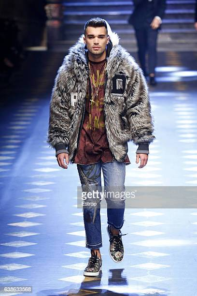 Celebrity Josh Cuthbert walks the runway at the Dolce Gabbana show during Milan Men's Fashion Week Fall/Winter 2017/18 on January 14 2017 in Milan...