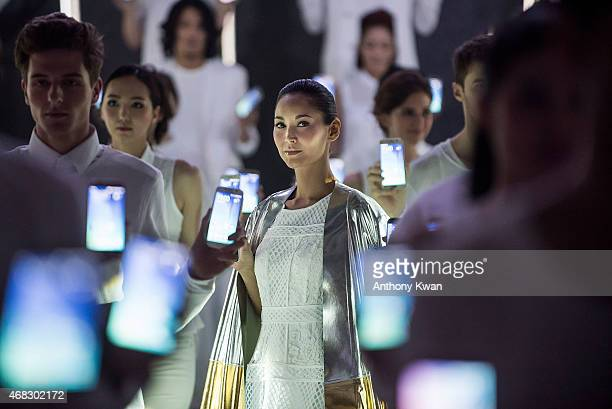 Celebrity model Amanda S showcases the Galaxy S6 edge during the Samsung new products press conference at Hullett House in Tsim Sha Tsui District on...
