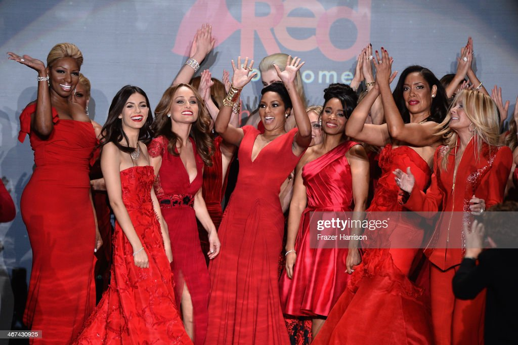 Celebrity models gather at the end of the runway at Go Red For Women - The Heart Truth Red Dress Collection 2014 Show Made Possible By Macy's And SUBWAY Restaurants at The Theatre at Lincoln Center on February 6, 2014 in New York City.