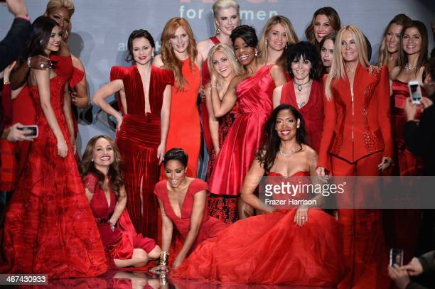 Celebrity models gather at the end of the runway at Go Red For Women The Heart Truth Red Dress Collection 2014 Show Made Possible By Macy's And...