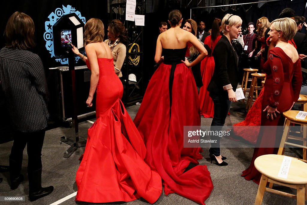 Celebrity models prepare backstage at The American Heart Association's Go Red For Women Red Dress Collection 2016 Presented By Macy's at The Arc, Skylight at Moynihan Station on February 11, 2016 in New York City.